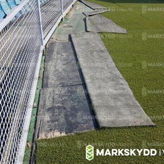 mats underneath fake grass